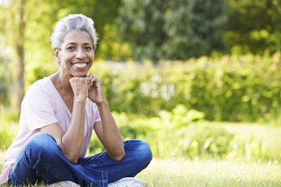 photo: Lady sitting in a garden. Investment Management | Flournoy Wealth Management