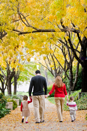 Photo of a family walking in autumn.