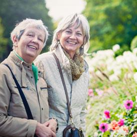 photo: two ladies in a city garden | Flournoy Wealth Management